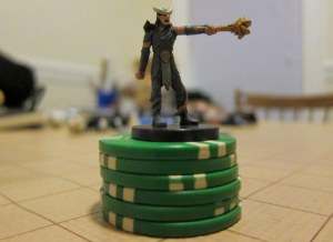 Tiefling on top of stack of power point tokens.